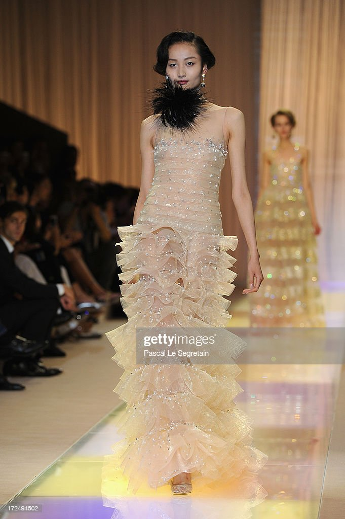 A model walks the runway during the Giorgio Armani Prive show as part of Paris Fashion Week HauteCouture Fall/Winter 20132014 at Theatre National de...