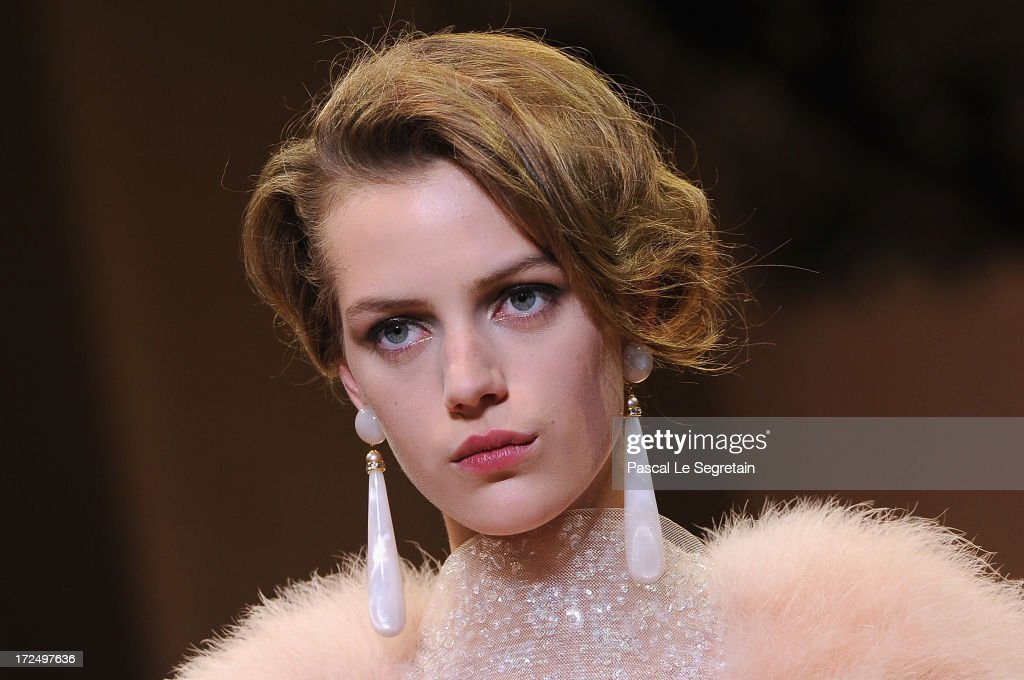 A model walks the runway during the Giorgio Armani Prive show as part of Paris Fashion Week Haute-Couture Fall/Winter 2013-2014 at Theatre National de Chaillot on July 2, 2013 in Paris, France.