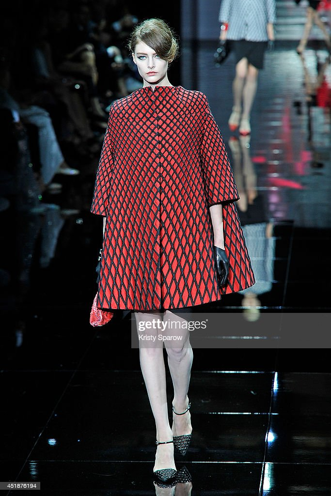 A model walks the runway during the Giorgio Armani Prive show as part of Paris Fashion Week Haute Couture Fall/Winter 20142015 at Theatre National de...
