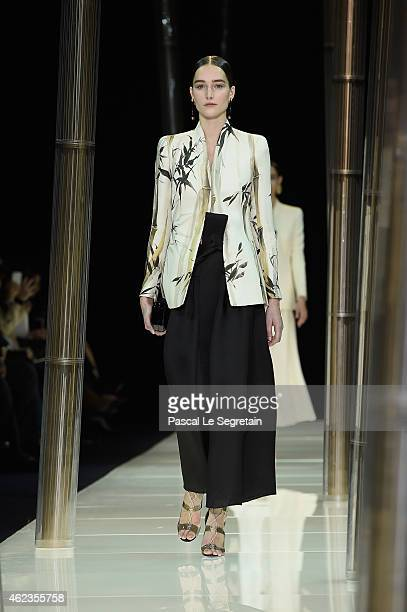 A model walks the runway during the Giorgio Armani Prive show as part of Paris Fashion Week Haute Couture Spring/Summer 2015 on January 27 2015 in...