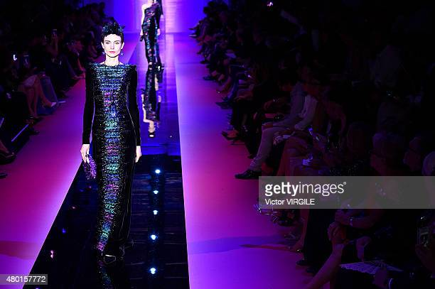 A model walks the runway during the Giorgio Armani Prive show as part of Paris Fashion Week Haute Couture Fall/Winter 2015/2016 on July 7 2015 in...