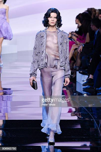 A model walks the runway during the Giorgio Armani Prive Spring Summer 2016 show as part of Paris Fashion Week on January 26 2016 in Paris France