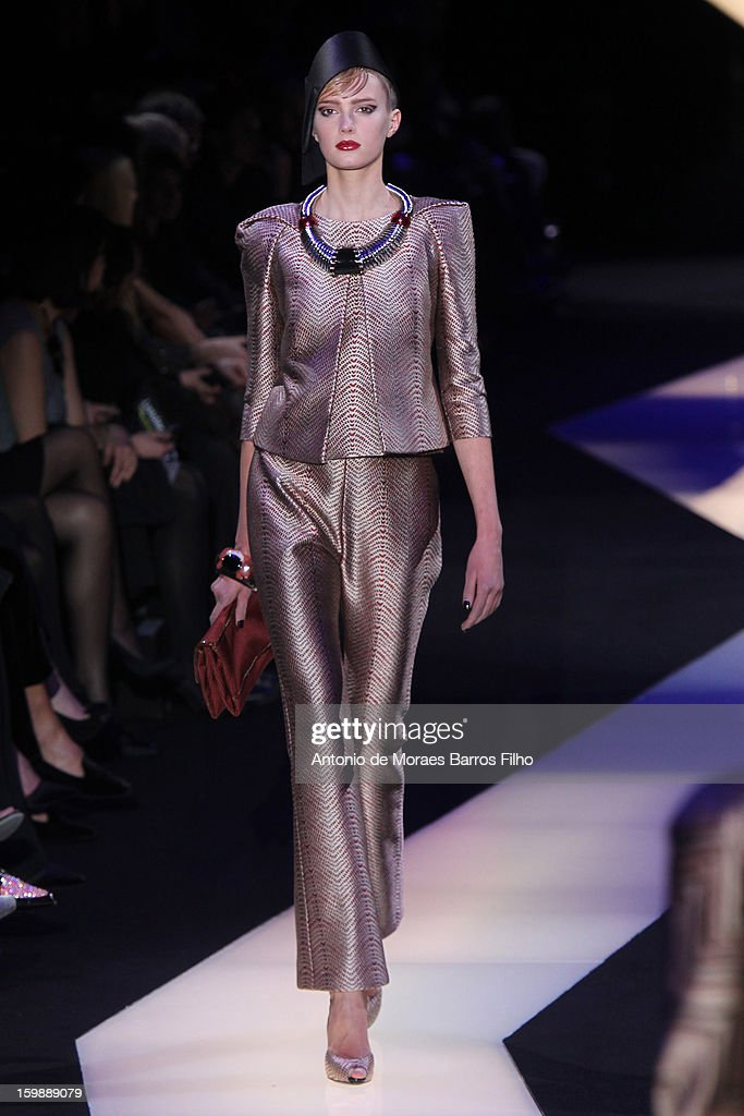 A model walks the runway during the Giorgio Armani Prive Spring/Summer 2013 Haute-Couture show as part of Paris Fashion Week at Theatre National de Chaillot on January 22, 2013 in Paris, France.