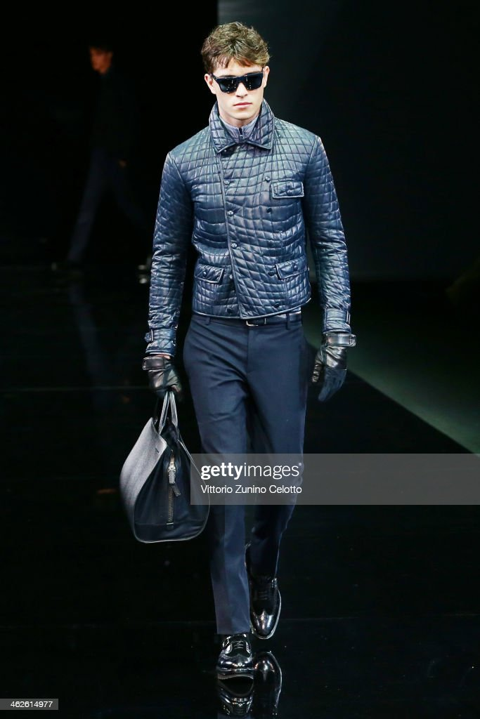 A model walks the runway during the Giorgio Armani show as a part of Milan Fashion Week Menswear Autumn/Winter 2014 on January 14 2014 in Milan Italy