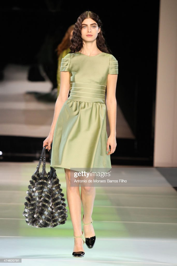 A model walks the runway during the Giorgio Armani show as a part of Milan Fashion Week Womenswear Autumn/Winter 2014 on February 24, 2014 in Milan, Italy.