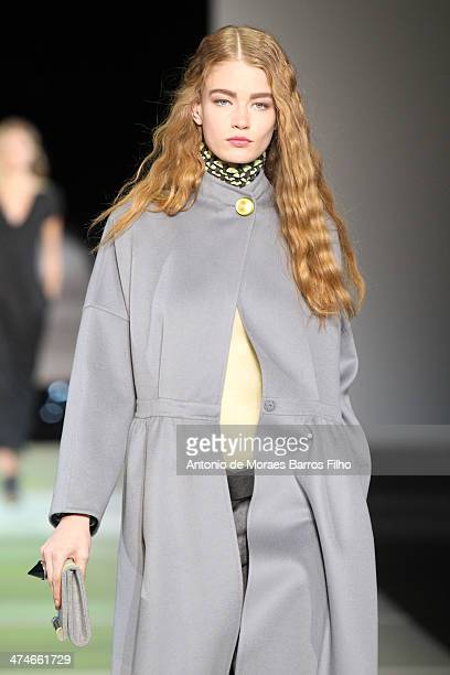 A model walks the runway during the Giorgio Armani show as a part of Milan Fashion Week Womenswear Autumn/Winter 2014 on February 24 2014 in Milan...