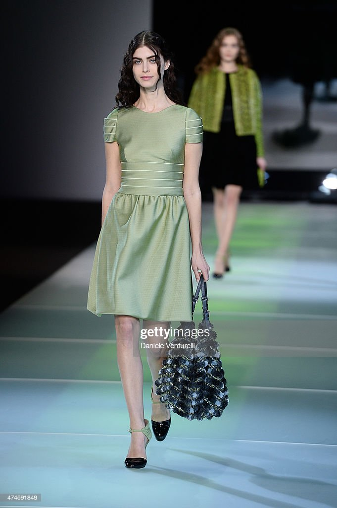 A model walks the runway during the Giorgio Armani show as part of Milan Fashion Week Womenswear Autumn/Winter 2014 on February 24, 2014 in Milan, Italy.