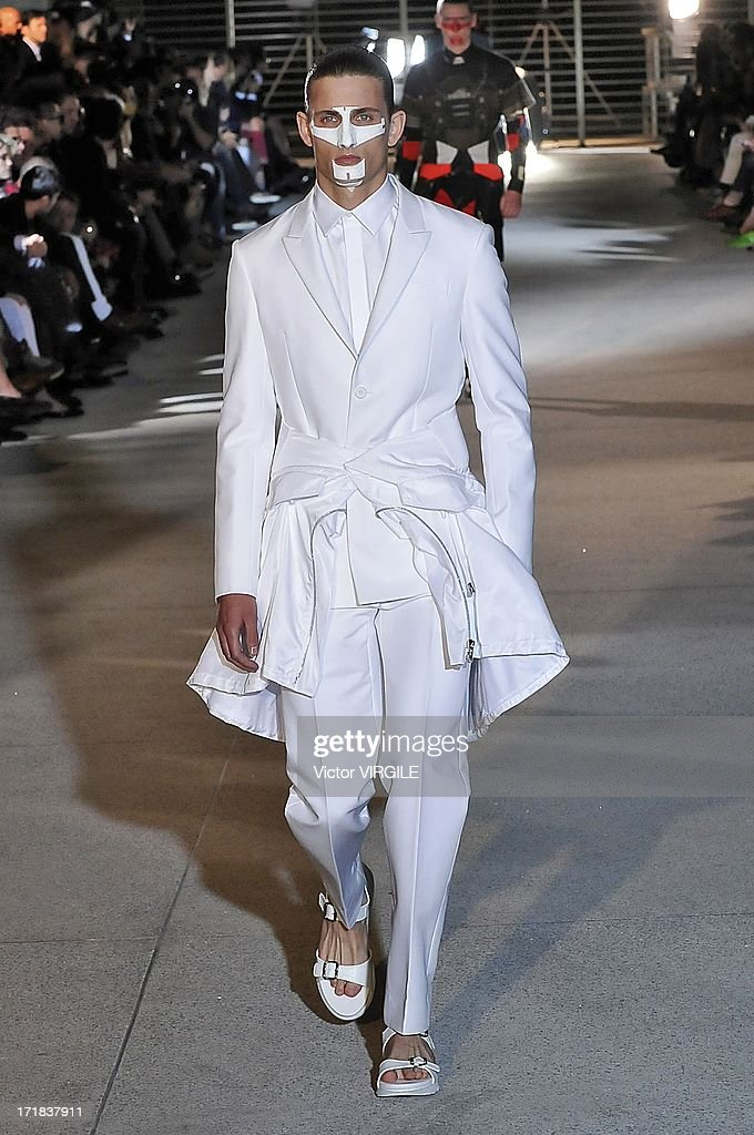A model walks the runway during the Givenchy Menswear Spring/Summer 2014 show as part of the Paris Fashion Week on June 28, 2013 in Paris, France.