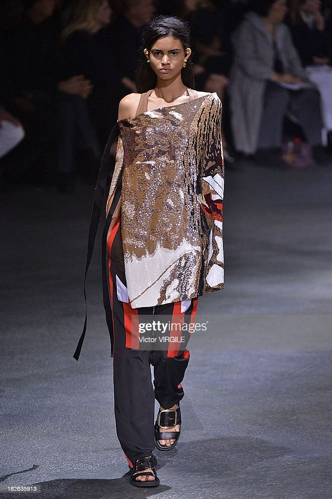 A model walks the runway during the Givenchy Ready to Wear show as part of the Paris Fashion Week Womenswear Spring/Summer 2014 held at 'la Halle Freyssinet' on September 29, 2013 in Paris, France.