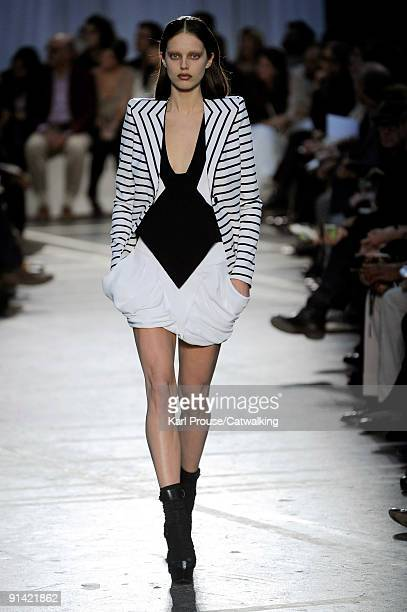 A model walks the runway during the Givenchy Ready To Wear show as part of the Paris Womenswear Fashion Week Spring/Summer 2010 on October 4 2009 in...