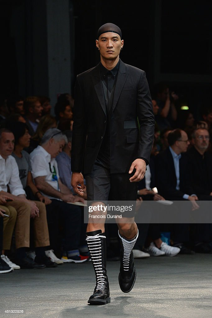 A model walks the runway during the Givenchy show as part of the Paris Fashion Week Menswear Spring/Summer 2015 on June 27, 2014 in Paris, France.