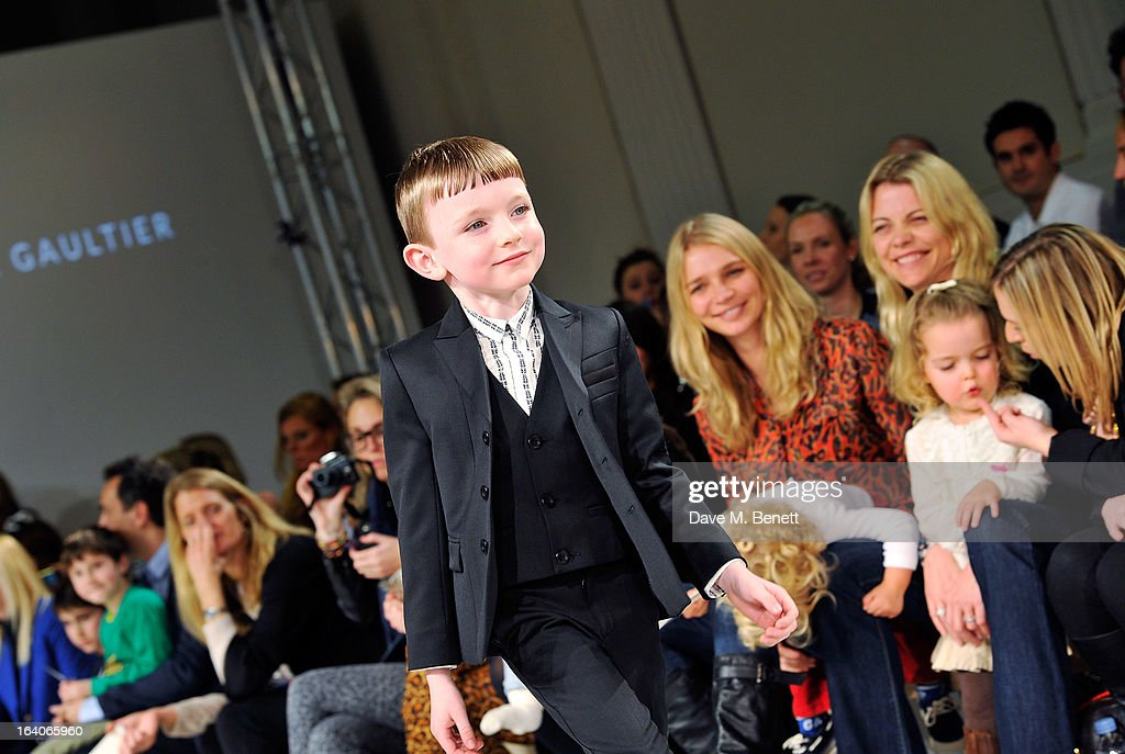 A model walks the runway during the Global Kids Fashion Week AW13 media and VIP show at The Freemason's Hall on March 19, 2013 in London, England.