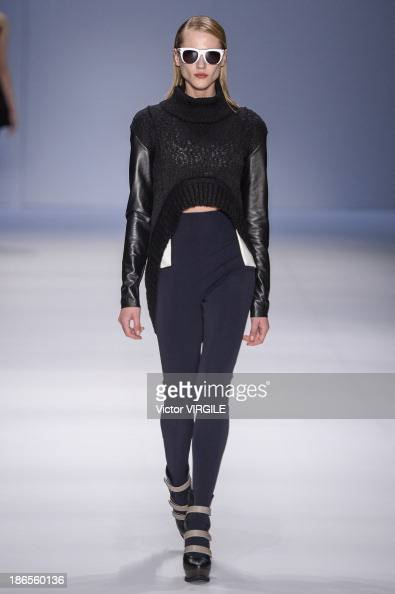 A model walks the runway during the Gloria Coelho show at the Sao Paulo Fashion Week Winter 2014 on October 31 2013 in Sao Paulo Brazil