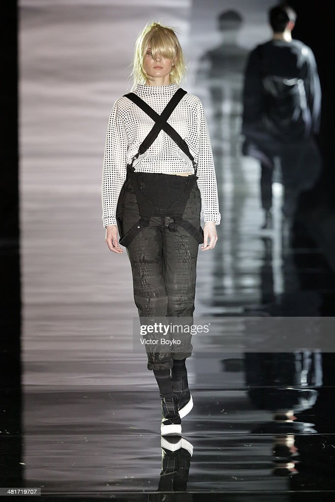 A model walks the runway during the Goga Nikabadze show on day 4 of Mercedes-Benz Fashion Week Moscow AW14 on March 30, 2014 in Moscow, Russia.