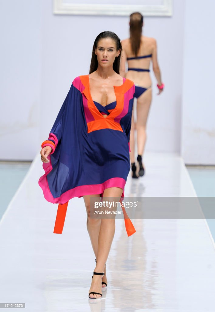 A model walks the runway during the Gottex fashion show at Mercedes-Benz Fashion Week Swim 2014 - Runway at SLS Hotel on July 21, 2013 in Miami, Florida.