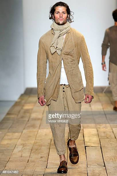 A model walks the runway during the Greg Lauren show at New York Fashion Week Men's S/S 2016 at Skylight Clarkson Sq on July 15 2015 in New York City