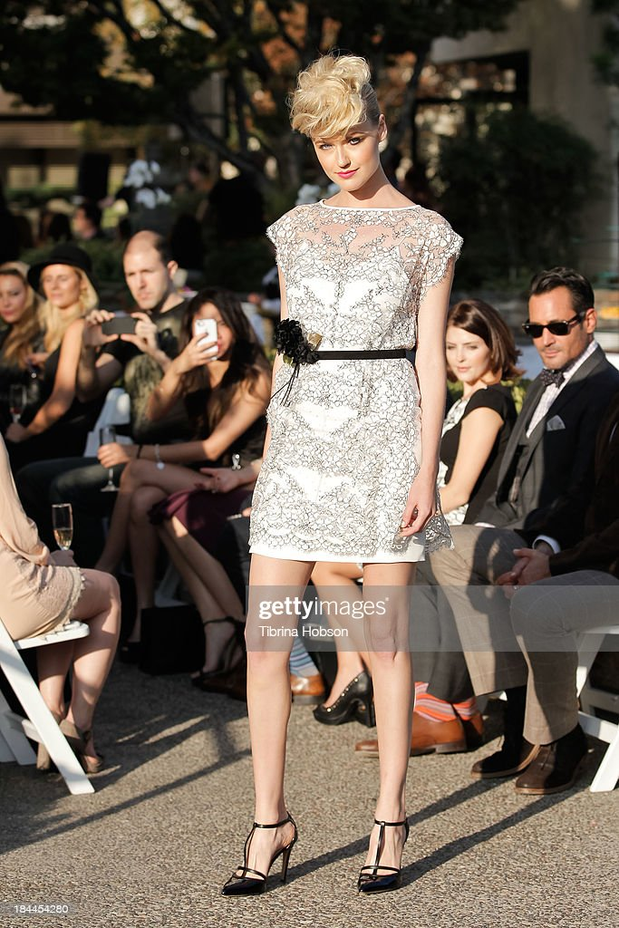 A model walks the runway during the Greg Lavoi spring 2014 runway presentation at Kyoto Gardens on October 13, 2013 in Los Angeles, California.