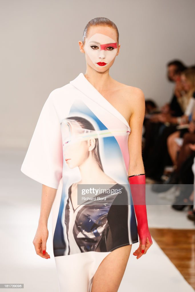 A model walks the runway during the Ground Zero show as part of the Paris Fashion Week Womenswear Spring/Summer 2014 on September 24, 2013 in Paris, France.