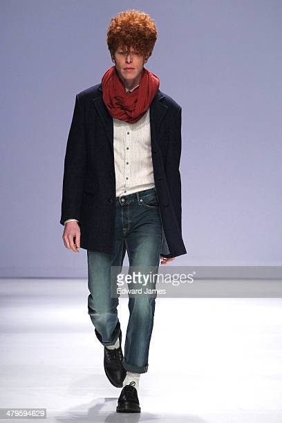 A model walks the runway during the Gsus Sindustries fashion show during World Mastercard fashion week on March 19 2014 in Toronto Canada