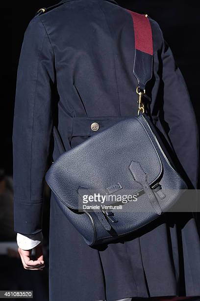 A model walks the runway during the Gucci show as part of Milan Fashion Week Menswear Spring/Summer 2015on June 23 2014 in Milan Italy