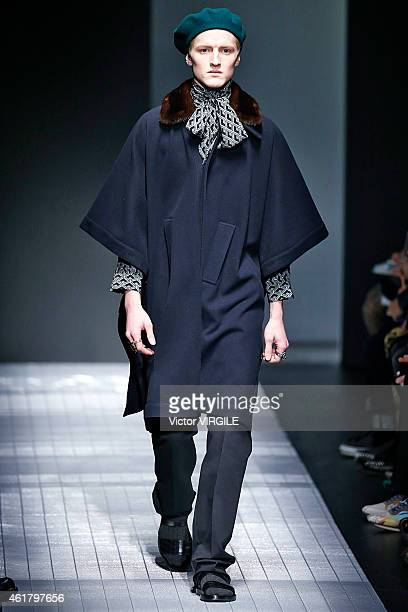 A model walks the runway during the Gucci show as part of Milan Menswear Fashion Week Fall Winter 2015/2016 on January 19 2015 in Milan Italy
