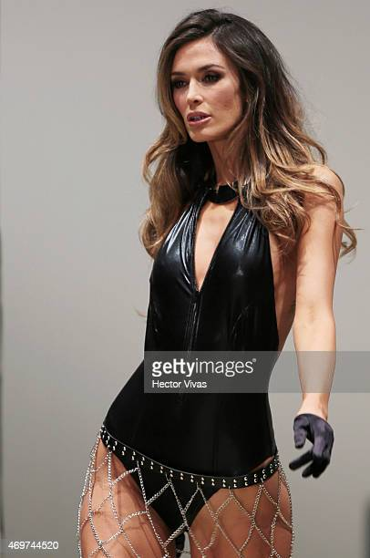 A model walks the runway during the Guess Show as part of MercedesBenz Fashion Week Mexico Fall/Winter 2015 day 1 at Campo Marte on April 14 2014 in...