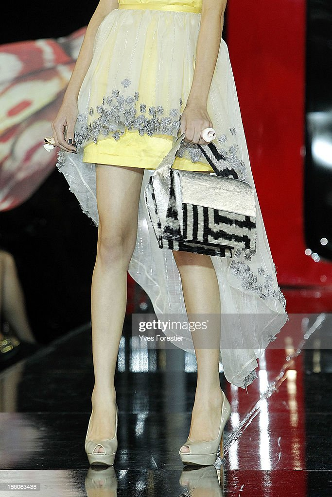 A model (jewels;shoes and bag detail) walks the runway during the Guli fashion show as part of the Art Style UZ 2013 at The Youth Art Palace on October 27, 2013 in Tashkent, Uzbekistan.