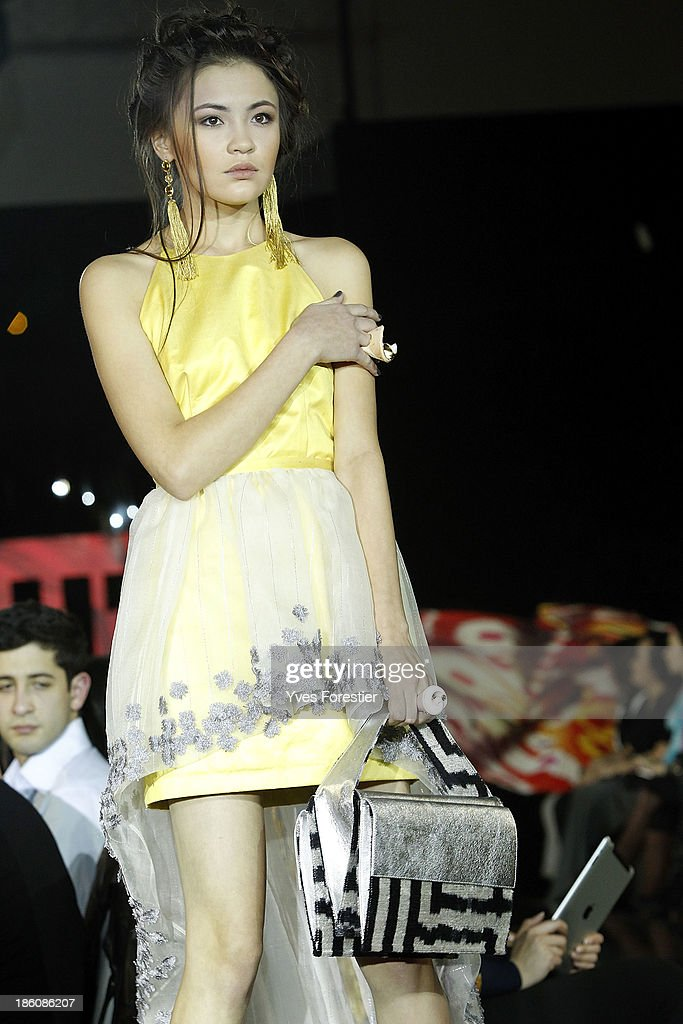A model walks the runway during the Guli fashion show as part of the Art Style UZ 2013 at The Youth Art Palace on October 27, 2013 in Tashkent, Uzbekistan.