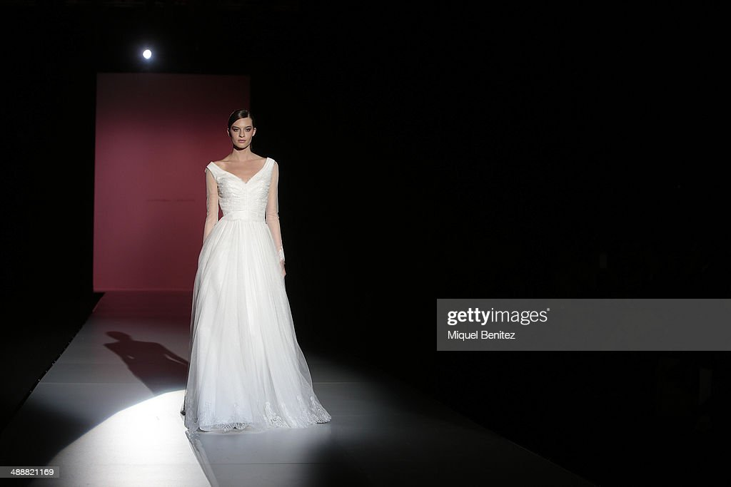 A model walks the runway during the Hannibal Laguna fashion show as part of 'Barcelona Bridal Week 2014' on May 8, 2014 in Barcelona, Spain.
