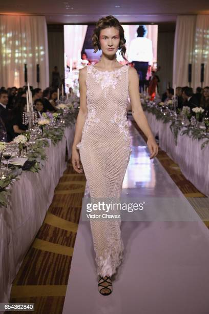A model walks the runway during the Happy Hearts Foundation gala at Sheraton Maria Isabel Hotel Towers on March 16 2017 in Mexico City Mexico