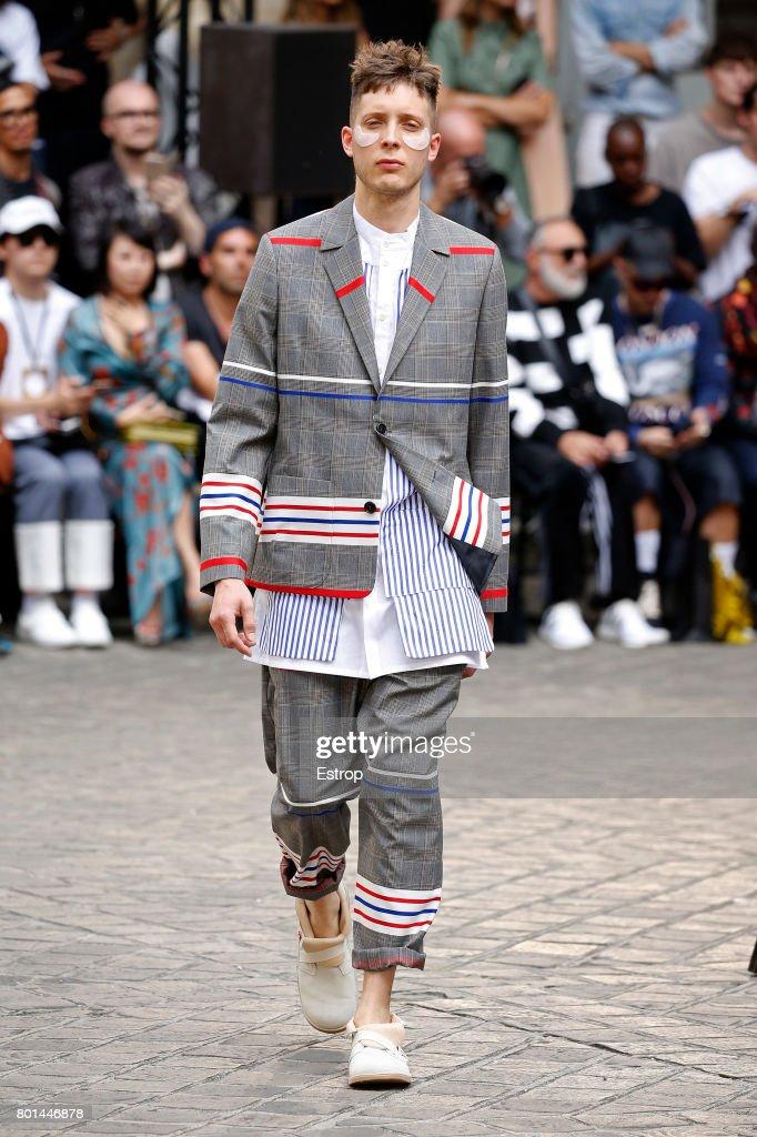 model-walks-the-runway-during-the-henrik-vibskov-menswear-2018-show-picture-id801446878