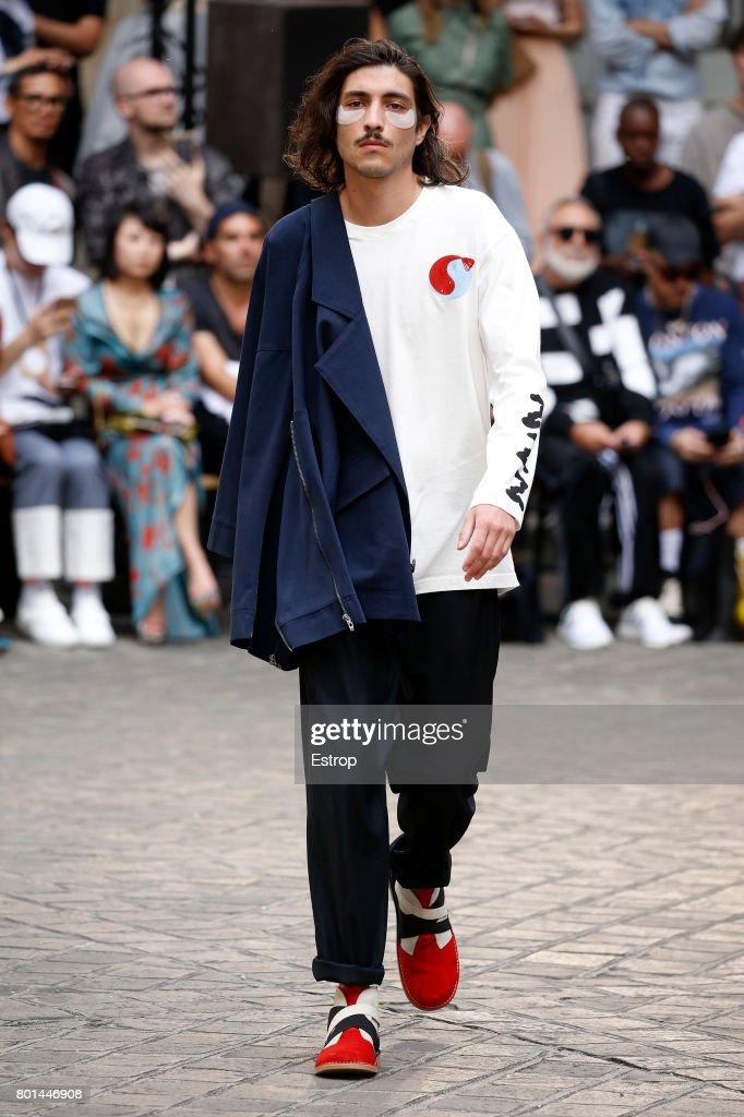model-walks-the-runway-during-the-henrik-vibskov-menswear-2018-show-picture-id801446908
