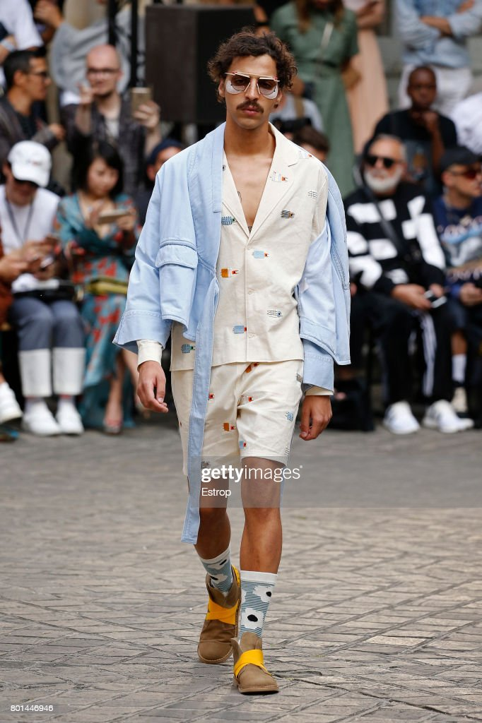 model-walks-the-runway-during-the-henrik-vibskov-menswear-2018-show-picture-id801446946