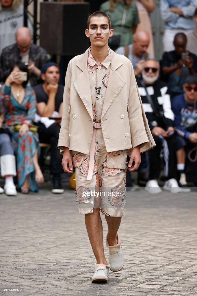 model-walks-the-runway-during-the-henrik-vibskov-menswear-2018-show-picture-id801446972