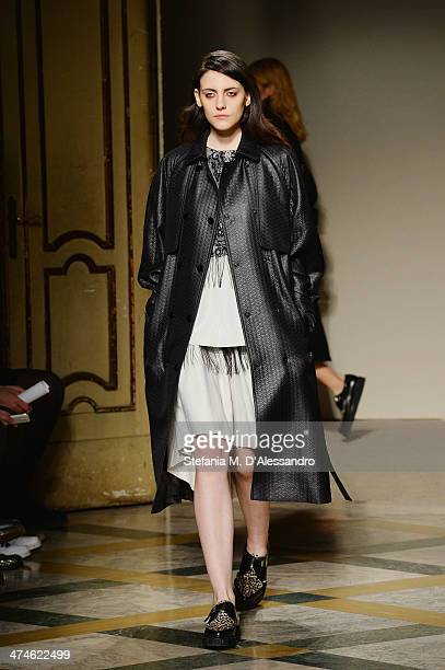 A model walks the runway during the Heohwan Simulation as a part of Milan Fashion Week Womenswear Autumn/Winter 2014 on February 24 2014 in Milan...