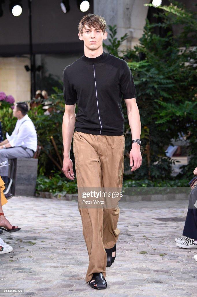 model-walks-the-runway-during-the-hermes-menswear-springsummer-2018-picture-id800646768