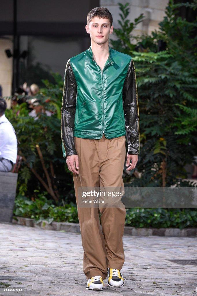model-walks-the-runway-during-the-hermes-menswear-springsummer-2018-picture-id800647590