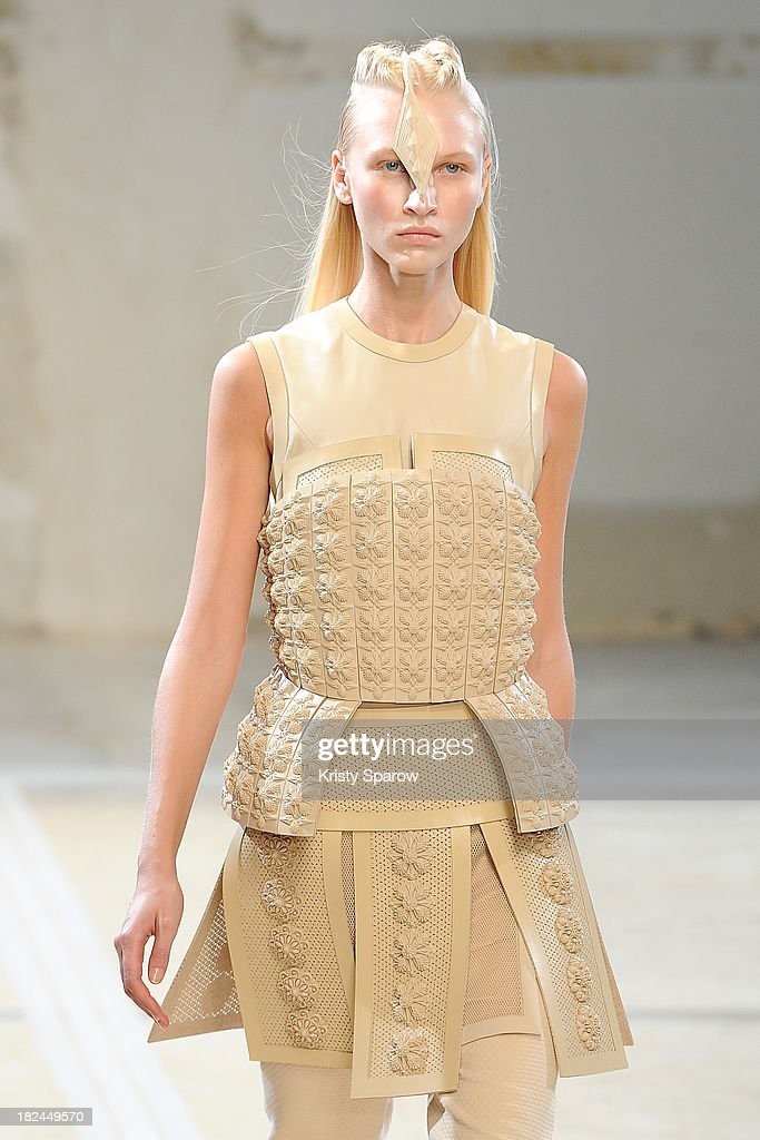 A model walks the runway during the Hexa By Kuho show as part of Paris Fashion Week Womenswear Spring/Summer 2014 on September 29, 2013 in Paris, France.