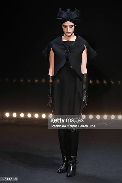 A model walks the runway during the Hiroko Koshino Ready to Wear show as part of the Paris Womenswear Fashion Week Fall/Winter 2011 at Le Carrousel...