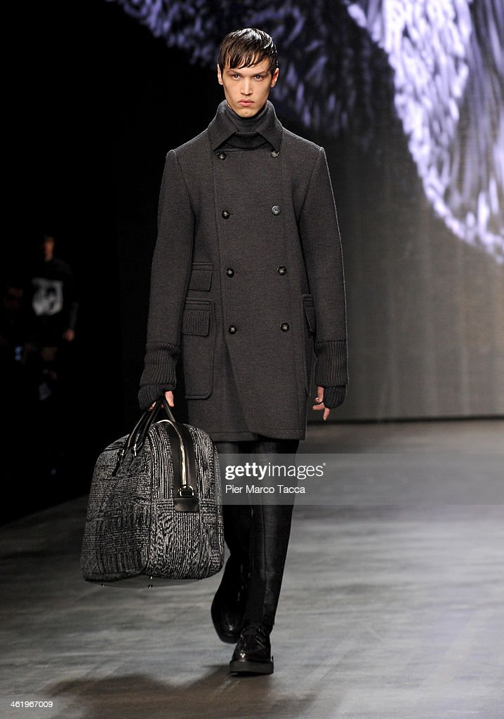 A model walks the runway during the Iceberg show as a part of Milan Fashion Week Menswear Autumn/Winter 2014 on January 12, 2014 in Milan, Italy.