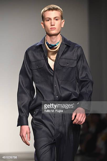 A model walks the runway during the Iceberg show as part of Milan Fashion Week Menswear Spring/Summer 2015 on June 22 2014 in Milan Italy