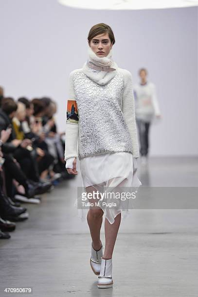 A model walks the runway during the Iceberg Show as part of Milan Fashion Week Womenswear Autumn/Winter 2014 on February 21 2014 in Milan Italy