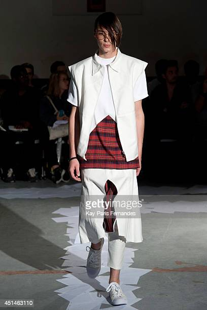 A model walks the runway during the Icosae show as part of the Paris Fashion Week Menswear Spring/Summer 2015 on June 29 2014 in Paris France