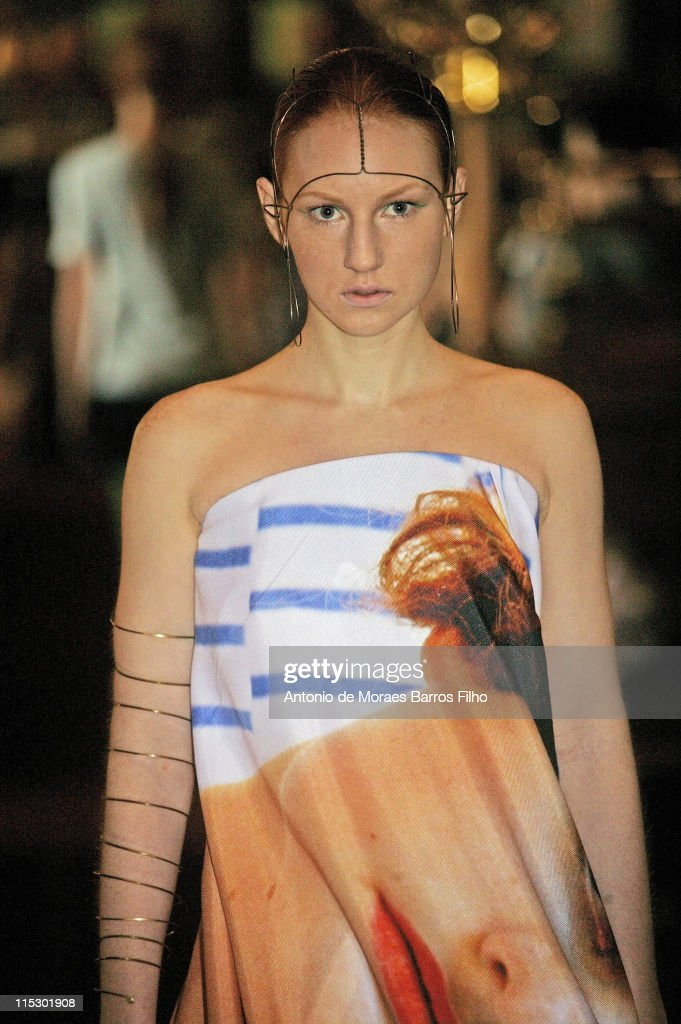 A model walks the runway during the Impasse de la Defense Pret a Porter show as part of the Paris Womenswear Fashion Week Spring/Summer 2010 at Gare...