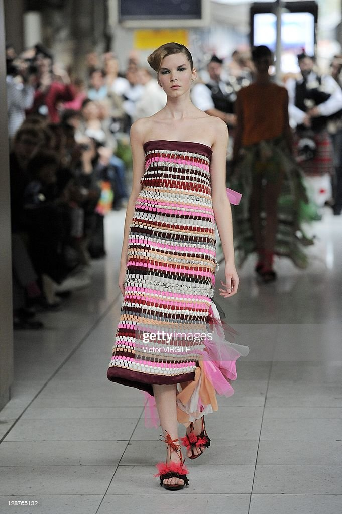 A model walks the runway during the Impasse De La Defense Ready to Wear Spring / Summer 2012 show during Paris Fashion Week at Gare d'Austerlitz on...