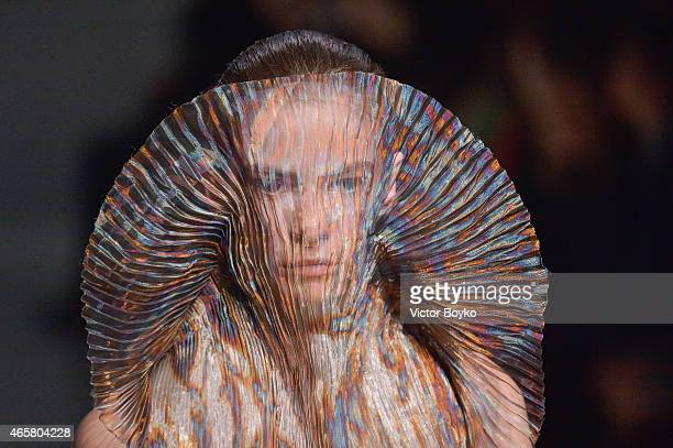 A model walks the runway during the Iris Van Herpen show as part of the Paris Fashion Week Womenswear Fall/Winter 2015/2016 on March 10 2015 in Paris...