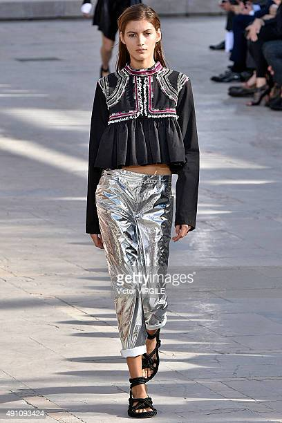 A model walks the runway during the Isabel Marant Ready to Wear show as part of the Paris Fashion Week Womenswear Spring/Summer 2016 on October 2...