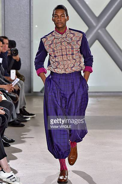 A model walks the runway during the Issey Miyake Men Menswear Fall/Winter 20152016 show at Fondation Cartier as part of the Paris Fashion Week on...
