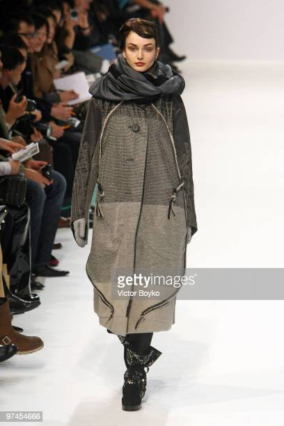 A model walks the runway during the Issey Miyake Ready to Wear show as part of the Paris Womenswear Fashion Week Fall/Winter 2011 at Le Carrousel du...