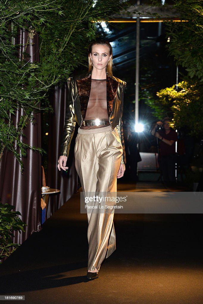A model walks the runway during the 'J'Aime La Mode' Cocktail Event Hosted by Chef Thierry Marx at Hotel Mandarin Oriental on September 23, 2013 in Paris, France.